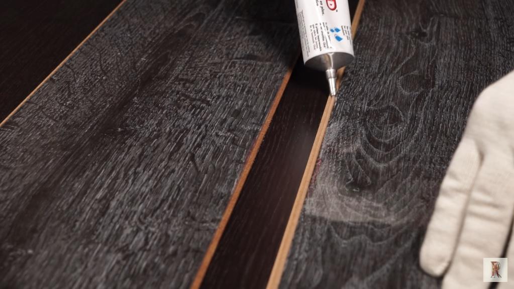 Нанесение герметика на ламинат